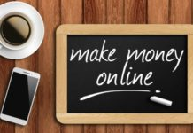 coffee, phone and chalkboard with make money online words.